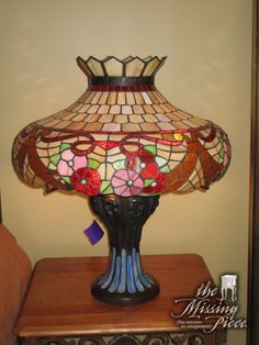 Add a touch of class to your room with this brass lamp. The multi-color stain glass style shade is sure to go with anything!