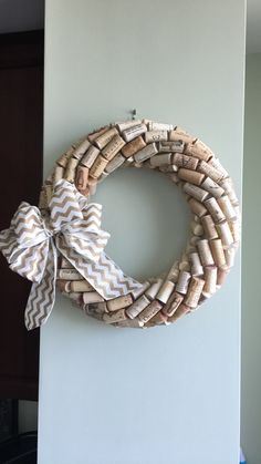 This wreath is hand made with wine corks. The bow color can be changed if requested. I can send you different color options as well, if you do want a different bow. Extra bows will have an extra fee attached. Email with any questions