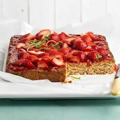 The rich peanut butter base for these delicious bars can be made ahead and frozen according to the recipe. Before guests arrive, simply thaw and top with jam and strawberries for a last-minute dessert.
