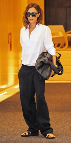 Victoria Beckham Swaps Her Stilettos for Flat Sandals in a Chic Androgynous Look The designer stepped out in New York Wednesday wearing a more low-key look during NYFW. Mode Victoria Beckham, Victoria Beckham Outfits, Victoria Beckham Fashion, Look Fashion, Fashion Outfits, Womens Fashion, Vic Beckham, Vetements Clothing, Androgynous Look