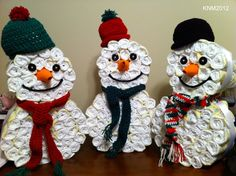 Diaper Snowmen - A gift for your Christmas baby. Rolled diapers with crocheted baby hats.