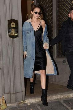Gigi Hadid black slip dress, long denim coat with fur lining - edgy glam street style 2016