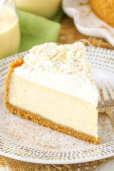Eggnog Cheesecake - perfect cheesecake for the holidays! This easy Eggnog Cheesecake recipe is thick, creamy and full of eggnog! A perfect dessert recipe for the holidays, it's a delicious way to enjoy one of my favorite drinks of the season. Köstliche Desserts, Christmas Desserts, Christmas Baking, Delicious Desserts, Dessert Recipes, Christmas Drinks, Eggnog Cheesecake, Christmas Cheesecake, Easy Cheesecake Recipes