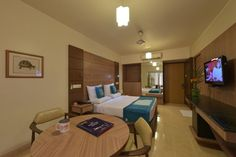 Book OYO 1014 Hotel Bellevue, Surat online @ with free cancellation. ✔Lowest price on hotel bookings ✔Deal and ✔Discounts Stay Cool, Best Budget, Best Location, Hotel Reviews, Corner Desk, Budget Hotels, Room, Furniture, Awesome