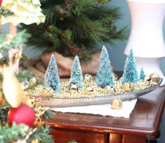 Elegant and classy, this metallic centerpiece can be made with bells, beads, and bottlebrush trees. Get the tutorial at Fynes Designs.   - CountryLiving.com