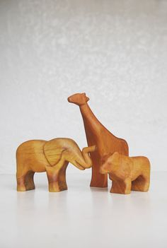 http://thepinkdoormat.blogspot.com/2013/06/hand-carved-animal-toys-by-abraham.html