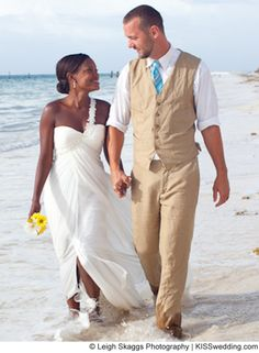 Semi formal men's beach wedding attire. Sandy colored linen suit, matching vest and white shirt. A bright blue tie. VERY cool looking.