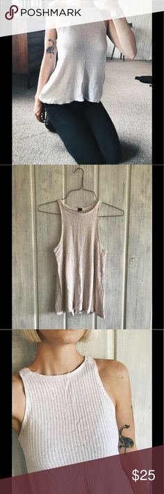 Free People Cream High Neck Tank, Women's xs-s Free People high neck tank sized xs, though runs slightly large and can fit a size small. Has been modified- used to have a turtle neck top. It's much better this way, and looks in true Free People fashion with an unfinished edge. Closer view of modification in photo with free People label. Excellent condition. 95% rayon, 5% spandex. Label recommends hand washing, though I have machine washed it multiple times and it has not changed in shape or…