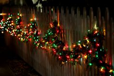 Fence adorned with beautiful Christmas lights . Days Till Christmas, Christmas Time Is Here, Noel Christmas, Outdoor Christmas, All Things Christmas, Christmas Lights, Christmas Wreaths, Christmas Decorations, Christmas Ideas