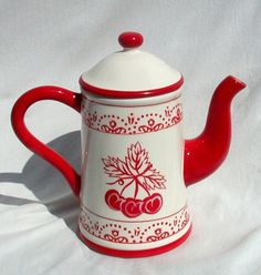 Vintage cherry coffee pot in red and white. Heartfelt Creations designed this super cheerful piece with a central motif of three ripe cherries bordered by a simple rosemaling tulip pattern top and bottom.