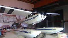 Super Cub with floats, this was the black plane before its paint job... building a super float plane stay tuned...