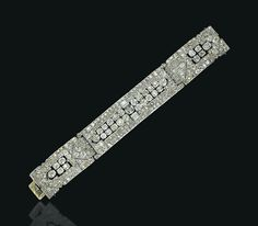 AN ART DECO DIAMOND BRACELET, BY CHAUMET  The three pavé-set diamond detachable panels each centering upon larger old-mine cut diamond collets, with baguette-cut diamond detail, 1930s, 17.4 cm, with French assay marks for platinum and gold Signed and with maker's mark for Chaumet & Cie Paris Londres, no. 1078