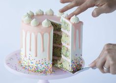 funfetti layer cake with italian meringue buttercream frosting and white chocolate ganache