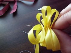 Ribbon Lei. I made a lei like this one last week for my husband's graduation. It was tricky, but completely worth it :)