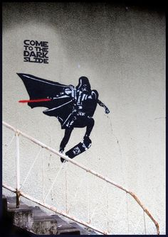 Daily Graffiti: Come To The Dark Slide Everything about this skateboarding Darth Vader piece by blouharthur is freaking perfect. Gotta' love when street artists stragically juxtapose their pieces with real-world surroundings. Check out the Daily Graffiti Archives for more geektastic street art! Add your geeky graffiti pics to our Group Pool on Flickr! Buy: Wall and Piece by BanksyPeep it: More fresh Star Wars posts