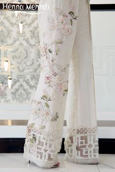 Ivory Crystal Embroidered & Embellished Trousers : Ivory raw silk boot cut trousers with pink crystal embroidery and embellishment. Please note these are trousers only. Please note delivery time is approximatel Pakistani Outfits, Indian Outfits, Fashion Pants, Fashion Dresses, Salwar Pants, Pants For Women, Clothes For Women, Mode Hijab, Indian Designer Wear