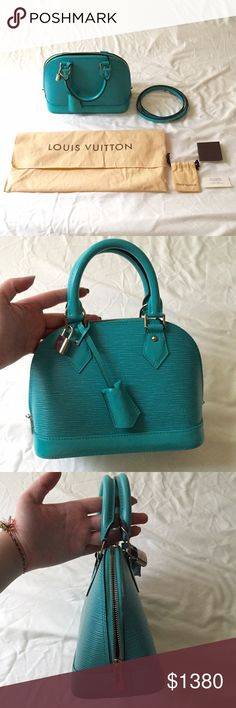 Louis Vuitton Turquoise Epi Alma BB Satchel Bag 100% Authentic Used once The exterior leather is clean throughout with a minor indentation to the rear of the bag (last picture). The handles have minor creasing to the undersides. The hardware is bright and clean with minor hairline surface scratches. The interior lining is clean and overall in excellent condition. Includes: Dust bag, booklet, tag, small pouch, leather clochette, keys, padlock & detachable strap Date/Authenticity Code: SN2115…
