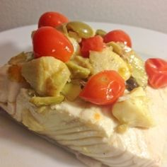Olive oil poached halibut with olives, capers and artichokes