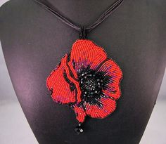 Red Beaded Rose Necklace,  Black Rose Necklace, Flower Necklace, Crystal Necklace, Hand Beaded Necklace, Beaded Necklace, Embroidered by JamieEstelleJewelry on Etsy https://www.etsy.com/listing/484207536/red-beaded-rose-necklace-black-rose