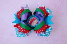 OTT Disney Princess Ariel Bottle Cap Hair Bow. $12.99, via Etsy.