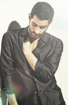 Tom Ellis. Love his pose, it's kind of thoughtful.  Picture found on Twitter by @TomEllisFans