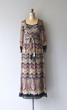 Vintage 1970s cotton blend maxi dress with fantastic multi-color & multi-pattern print, square neckline, long cuffed sleeves, high, fitted waist with