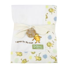 Keep your little one warm and secure with this Dr. Seuss The Lorax Framed Receiving Blanket by Trend Lab. Soft, recycled fleece is framed by an unbleached cotton Lorax and Truffula tuft scatter print