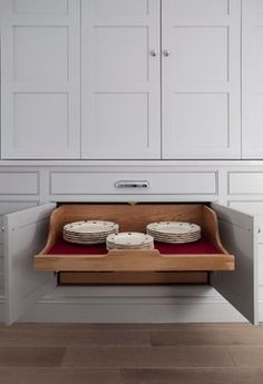 Gray cabinetry, natural wood pull-outs | Woodale Designs
