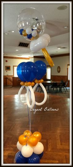 Pacifier balloons for baby shower and rattle in back