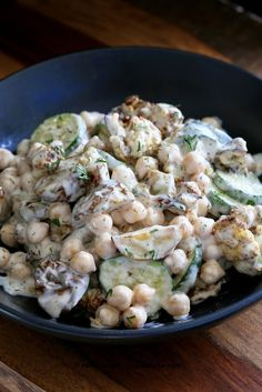 Summery Vegan Potato Salad with roasted potatoes, roasted Cauliflower, chickpeas and zucchini tossed in a vegan sour cream and onion dressing. Potato Salad Recipe Easy, Vegan Potato Salads, Healthy Salad Recipes, Vegan Recipes Easy, Cauliflower Potatoes, Vegan Cauliflower, Cauliflower Recipes, Roasted Potatoes, Vegan Zucchini