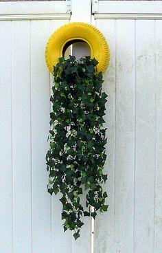 tire planters, gardening, repurposing upcycling, Tire planter mounted to deck wall Tire Garden, Garden Art, Garden Design, Pallets Garden, Fence Design, Tire Planters, Garden Planters, Tire Craft, Tyres Recycle