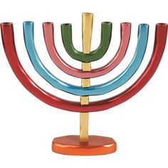 This Yair Emanuel Anodized Aluminum Hanukkah Menorah features bright colors and a traditional design. The Menorah's branches appear in shades of red, blue and green, the base is orange and th… Hanukkah Candles, Hanukkah Menorah, Hanukkah Gifts, Jewish Gifts, Happy Hannukah, Branches, Electric Menorah, Shabbat Candlesticks, Bat Mitzvah Gifts