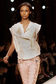 Isabel Marant square-cut vest. The shoulders are extended, visually broadening them, but the vest is still feminine.