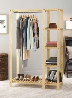 Whitmor's Slat Wood Wardrobe adds additional space to your bedroom or closet while also showcasing the beauty of wood built products. The unit features lacquer finished natural wood with a metal hangi Pallet Wardrobe, Diy Wardrobe, Open Wardrobe, Pallet Closet, Wardrobe Design, Wardrobe Ideas, Portable Closet, Diy Casa, Garment Racks