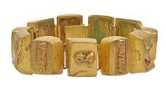 """Line Vautrin, Les Sept Péchés Capitaux, France  ca. 1947  """"The Seven Deadly Sins""""  A bronze doré bracelet    Each face on the bracelet illustrates one of the seven deadly sins."""