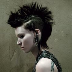 The first official photos of The Girl With the Dragon Tattoo's Rooney Mara in full costume have arrived. Rooney Mara as The Girl With the Dragon Tattoo is pretty intense stuff. Mara Rooney, Dragon Tattoo Images, Dragon Tattoos, Jean Paul Goude, Estilo Punk Rock, Lisbeth Salander, Fake Gauge Earrings, Hoop Earrings, Nicolas Ghesquière