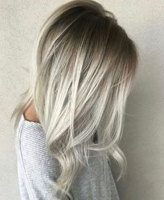 Neutral-rooted blonde balayage fading into platinum mids and ends. Stunning color and technique— love the volume of this blowdry and cut, too.