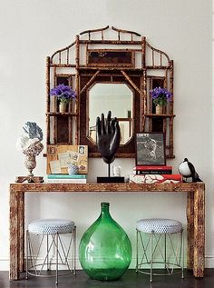 A bamboo console table makes the perfect place for an eclectic mix of vintage and global accent pieces.