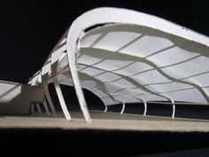 A conceptual architectural model of a natatorium with a hung canvas roof to allow for diffused lighting