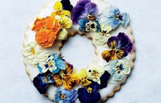 Candied herbs, edible dried flowers, and freeze-dried berries are beautiful decorations for these iced cookie wreaths. Learn how to make the shortbread in this video.