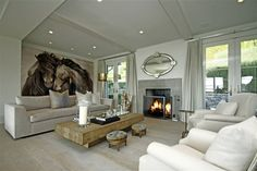 Modern Glamour On Compo Beach in Westport CT. Beautiful Roberto Dutesco photography. Stunning fireplace and antique French wide plank flooring.