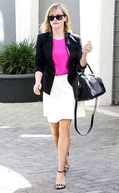 Reese Witherspoon adds a pop of Elle Woods' favorite color to her business-chic look!