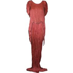 Mariano  Fortuny Sienna Peplos Gown This dress is made of finely pleated sienna colored silk with silk cording along side seams,shoulders and tunic hem with multicolored glass beads threaded through the cording.
