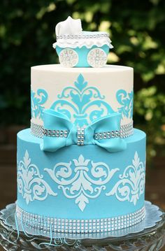 Baby shower cake with damask, fondant baby carriage, rhinestone bling, for baby boy. Visit HoneyLove at www.HoneyLoveCakery.com and follow on FB, twitter, and instagram.
