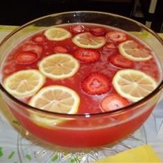JUANITA'S **AWESOME** PUNCH! Luscious Slush Punch (2 1/2 cups white sugar      6 cups water      2 (3 ounce) packages strawberry flavored Jell-O® mix      1 (46 fluid ounce) can pineapple juice      2/3 cup lemon juice      1 quart orange juice      2 (2 liter) bottles lemon-lime flavored carbonated beverage) THE BEST I'VE EVER HAD!
