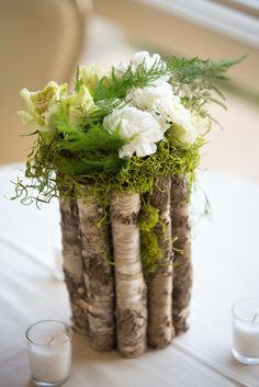 Wood, Moss, Carnation Centerpieces | Melissa Maureen Photography https://www.theknot.com/marketplace/melissa-maureen-photography-durham-nc-767049 | Firefly Event Company | Two Buds And A Blossom https://www.theknot.com/marketplace/two-buds-and-a-blossom-weaverville-nc-442523