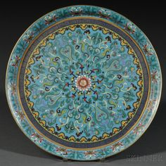 Cloisonne Charger, China, 19th/20th century, decorated with lotus scrolls and two borders of ruyi head and meander motifs on the interior, the exterior with a band of lotus motifs on the cavetto, and the base with flowers and butterflies, dia. 15 1/2 in.