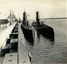 Rota Spain - US Navy conventional submarines - circa 1967. USS Canopus (AS34) in the background.