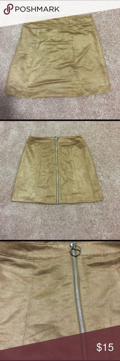 "H&M Divided Faux Suede Skirt Camel colored faux suede with a full length back zipper in a silver tone hardware . Circular ring pull on the zipper . Fabric content label has been removed . 15"" top of waistband to hemline. 13.75"" across top of waistband. No stretch . H&M Divided Skirts Mini"