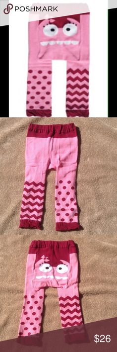 Pink Monster Cozy Leggings These adorable leggings are constructed to fit over a cloth diaper. Super stretchy. 75% cotton. 22% nylon, 3% spandex. Available in S( fits 3-12 mo), and M(fits 12-18 mo). sandystarfish Bottoms Leggings